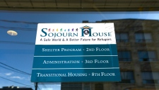 A sign on the front door of Sojourn House shelter