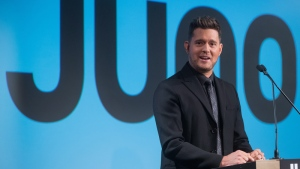 Michael Buble pauses while speaking after being introduced as the host of the 2018 Juno Awards, which will be held in Vancouver, during an announcement in Vancouver, B.C., on Tuesday November 21, 2017. THE CANADIAN PRESS/Darryl Dyck
