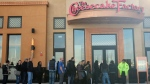 People stand line for the opening of a new Cheesecake Factory restaurant at Yorkdale shopping centre in Toronto on Tuesday Nov. 21, 2017. This is the first Cheesecake Factory location in Canada. (THE CANADIAN PRESS/Giordano Ciampini)