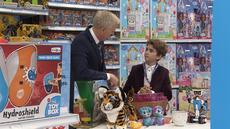 """Toys """"R"""" Us' Chief Play Officer, Emile Burbidge shows Ross McLaughlin this year's must-have toys. (CTV)"""