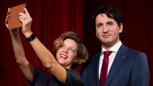 Grevin Montreal museum Managing Director Kathleen Payette poses for a selfie next to a wax sculpture of Prime Minister Justin Trudeau during a ceremony at the museum in Montreal, Tuesday, November 21, 2017. (Graham Hughes / THE CANADIAN PRESS)