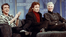 """FILE - In this July 13, 1993, file photo, former Partridge Family cast members David Cassidy, from left, Danny Bonaduce and Shirley Jones reunite on the Arsenio Hall Show, Los Angeles, Calif. This was the first time the three had appeared together since the popular 1970s series left the air. Cassidy performed I Think I Love You, during the taping. Former teen idol Cassidy of """"The Partridge Family"""" fame has died at age 67, publicist said Tuesday, Nov. 21, 2017. (AP Photo/Eric Draper, File)"""
