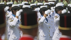 Female members of Indonesian Navy salute during a ceremony commemorating the Independence Day at Merdeka Palace in Jakarta, Indonesia on Aug. 17, 2012. (AP / Dita Alangkara)