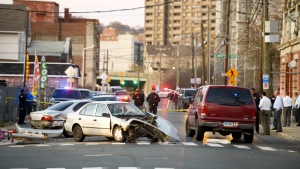 Waterbury police investigate a car crash on South Main Street at East Liberty Street in Waterbury, Conn., Tuesday, Nov. 21, 2017.(Jim Shannon / Republican-American)
