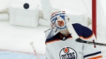 Edmonton Oilers goalie Laurent Brossoit looks at a puck as it sails past for a goal by St. Louis Blues' Paul Stastny during the third period of an NHL hockey game in St. Louis on Tuesday, Nov. 21, 2017. (AP / Jeff Roberson)