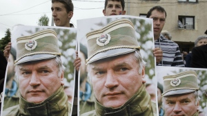 Bosnian Serb protesters are seen  holding posters depicting former Bosnian Serb army chief Ratko Mladic, during a protest in Mladic's hometown of Kalinovik, Bosnia-Herzegovina on May 29, 2011. (AP / Amel Emric)