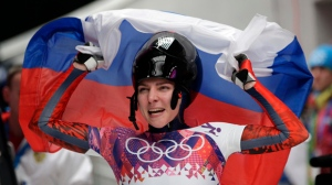 FILE - In this Friday, Feb. 14, 2014 file photo, Elena Nikitina of Russia celebrates her bronze medal win during the women's skeleton competition at the 2014 Winter Olympics, in Krasnaya Polyana, Russia. (AP Photo/Michael Sohn, File)