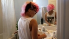 In this Thursday, June 22, 2017 photo, Theo Ramos, 15, cleans makeup brushes at home in Homestead, Fla. Ramos is embracing his gender fluidity, meaning that whether he identifies as male or female can change, depending on day or mood. (AP Photo/Lynne Sladky)