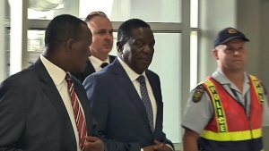 In this photo taken from video, Zimbabwe's incoming leader Emmerson Mnangagwa, centre, walks into an airport to board a flight bound for Zimbabwe, at Lanseria Airport, northwest of Johannesburg, South Africa, Wednesday, Nov. 22, 2017. (AP)