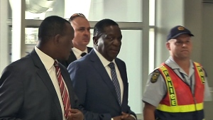 In this photo taken from video Zimbabwe's incoming leader Emmerson Mnangagwa, centre, walks into an airport to board a flight bound for Zimbabwe, at Lanseria Airport, north west of Johannesburg, South Africa, Wednesday, Nov. 22, 2017. Mnangagwa emerged from hiding Wednesday, departing from neighboring South Africa to return home in preparation to take power after Robert Mugabe's stunning resignation. (AP)