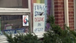 A sign demanding an apology for transgender students hangs in the window of the Rainbow Centre at Wilfrid Laurier University's Waterloo campus.