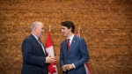 British Columbia Premier John Horgan, left, and Prime Minister Justin Trudeau talk during a photo opportunity in Vancouver, B.C., on Thursday November 16, 2017. (Darryl Dyck/The Canadian Press)