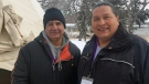 Firekeepers Ralph Arcand, left, and Alvin Baptiste pose for a photo near the South Saskatchewan River in Saskatoon. The two have been tending to a sacred fire burning inside a teepee since the missing and murdered Indigenous women and girls inquiry started Monday. (Angelina Irinici/CTV Saskatoon)