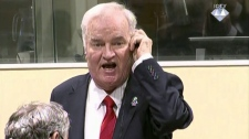 Bosnian Serb military chief Ratko Mladic during an angry outburst in the Yugoslav War Crimes Tribunal in The Hague, Netherlands, Wednesday, Nov. 22, 2017. The United Nations' Yugoslav war crimes tribunal ordered Bosnian Serb military chief Gen. Ratko Mladic out of the courtroom over an angry outburst during Wednesday's verdict determining whether he is guilty of genocide, crimes against humanity and war crimes over Bosnia's devastating 1992-95 war. (ICTY via AP)