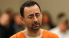 Dr. Larry Nassar, 54, appears in court for a plea hearing in Lansing, Mich., Wednesday, Nov. 22, 2017. Nasser, a sports doctor accused of molesting girls while working for USA Gymnastics and Michigan State University pleaded, guilty to multiple charges of sexual assault and will face at least 25 years in prison. (AP Photo/Paul Sancya)