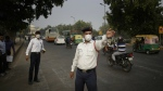 Ram Sharan, 28, right, a traffic police officer manages traffic in New Delhi, India on Nov. 16, 2017. (AP / Altaf Qadri)