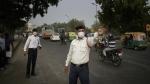 Ram Sharan, 28, right, a traffic police officer manages traffic in New Delhi, India on Nov. 16, 2017. (AP / Altaf Qadri)