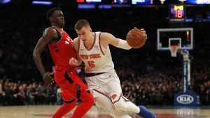 New York Knicks forward Kristaps Porzingis drives against Toronto Raptors forward Pascal Siakam during the third quarter of an NBA basketball game in New York on Wednesday, Nov. 22, 2017. (AP / Julie Jacobson)