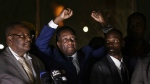 Zimbabwe's President in waiting Emmerson Mnangagwa, centre, greets supporters gathered outside the Zanu-PF party headquarters in Harare, Zimbabwe on Wednesday, Nov. 22, 2017. (AP / Ben Curtis)