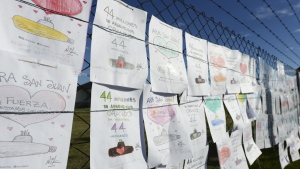 Drawings by children in support of the crew of the missing submarine ARA San Martin, hang from the fence of the Mar del Plata Naval Base, in Argentina, Wednesday, Nov. 22, 2017. (AP / Marina Devo)
