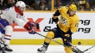 HOCKEY 18034797Nashville Predators left wing Kevin Fiala, right, of Switzerland, tries to control the puck asMontreal Canadiens' Karl Alzner, left, defends during the second period of an NHL hockey game Wednesday, Nov. 22, 2017, in Nashville, Tenn. (AP Photo/Mark Humphrey)