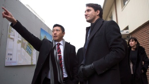 Prime Minister Justin Trudeau (right) stands with Jason Chen, Development Director at Toronto Community Housing as he visits a housing development in Toronto's Lawrence Heights neighbourhood ahead of a policy announcement, on Wednesday November 22, 2017. (THE CANADIAN PRESS/Chris Young)