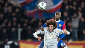 Basel's Eder Balanta up, fights for the ball against Manchester United's Marouane Fellaini, during the Champions League Group A soccer match between Switzerland's FC Basel 1893 and England's Manchester United in Basel, Switzerland, Nov. 22, 2017. (Ennio Leanza/Keystone via AP)