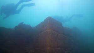 Divers investigate a fortress discovered at the bottom of Lake Van in Turkey. (YouTube / National Geographic)