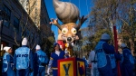 Participants stand below a parade balloon before the Macy's Thanksgiving Day Parade begins in New York, Thursday, Nov. 23, 2017. (AP / Craig Ruttle)