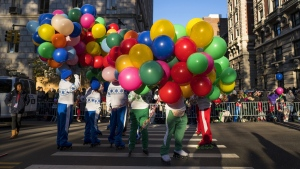 Participants take their place along the parade route before the Macy's Thanksgiving Day Parade begins in New York, on Nov. 23, 2017. (Craig Ruttle / AP)