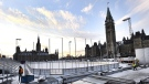 Construction continues on the skating rink on Parliament Hill in Ottawa on Monday, Nov. 20, 2017. The rink is part of a $5.6 million budget that includes a contest to bring 32 peewee house league hockey teams from across the country to Ottawa for a tournament after Christmas. The rink comes complete with cooling system, grandstands and boards. But outside of the tournament and a few other assorted events, there will be no hockey allowed on the ice. Also no food, no rough housing, no tag, no figure or speed skating, and no carrying of children. (Justin Tang/THE CANADIAN PRESS)