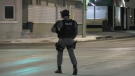 A Barrie police tactical officer walks around the scene of a gun call near the Allandale GO Station in Barrie, Ont. on Thursday, Nov. 23, 2017. (CTV Barrie)