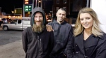 Johnny Bobbitt Jr., left, Kate McClure, right, and McClure's boyfriend Mark D'Amico pose at a Citgo station in Philadelphia on Nov. 17, 2017. (Elizabeth Robertson/The Philadelphia Inquirer via AP)