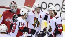 Ottawa Senators left wing Mike Hoffman (68) celebrates his goal with right wing Mark Stone (61), center Derick Brassard (19) and defenseman Cody Ceci (5) during the third period of an NHL hockey game as Washington Capitals goalie Braden Holtby, top left, looks on, Wednesday, Nov. 22, 2017, in Washington. The Capitals won 5-2. (Nick Wass/AP Photo)