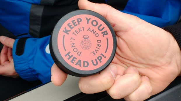 York Regional Police launch a hockey themed distracted driving awareness campaign where they hand out branded hockey pucks. (York Regional Police/Twitter)