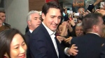 Prime Minister Justin Trudeau is swarmed by supporters at Bridlewood Mall in Toronto, Ont., on Nov. 22, 2017.