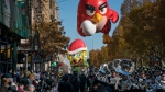 A balloon of Red, from Angry Birds, is followed by a Spongebob Squarepants balloon along Central Park West during the Macy's Thanksgiving Day Parade in New York Thursday, Nov. 23, 2017. (Craig Ruttle/AP Photo)