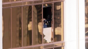 Investigators work in the room at the Mandalay Bay Resort and Casino in Las Vegas, from which shooter Stephen Paddock carried out his murderous rampage on Oct. 1, in this photo taken on Oct. 4, 2017. (Gregory Bull/AP Photo)