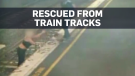 Woman rescued from oncoming train