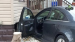 A black sedan smashed into a house on Wyandotte Street East on Thursday, Nov. 23, 2017. (Rich Garton / CTV Windsor)
