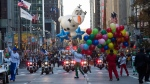 The Olaf balloon floats down Sixth Avenue during the Thanksgiving Day parade in New York, Thursday, Nov. 23, 2017. (AP Photo/Mary Altaffer)