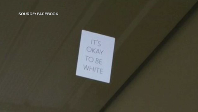 """""""It's okay to be white"""" poster."""