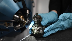 An antique bronze sculpture is analyzed using the latest version of the AGLAE. (Stephane de Sakutin/AFP)