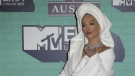 British singer-songwriter Rita Ora poses on the red carpet arriving to attend the 2017 MTV Europe Music Awards (EMA) at Wembley Arena in London on November 12, 2017. (Daniel Leal-Olivas/AFP)