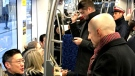 TTC CEO Andy Byford is seen talking to passengers on a streetcar. (CTV News Toronto/Natalie Johnson)