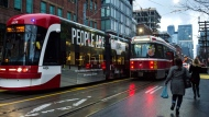 Streetcars travels along King Street West during the King Street Pilot Project.