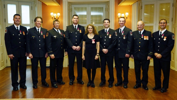 Governor General Julie Payette(centre)poses for a photograph with Matthew Attwell of Barrie, Ont., Anthony Colabufalo of Caledon, Ont., Fire Captain James Hicks of Algonquin Highlands, Ont., Larry Martin of Aurora, Ont., Marcus Middleton of Richmond Hill, Ont., Travis Robbins of Oshawa, Ont., Daryl Roy of Palgrave, Ont., and Derek Wilson of Barrie, Ont., after they were presented with the Medal of Bravery during a ceremony at Rideau Hall the official residence of the Governor General in Ottawa, Thursday, November 23, 2017. THE CANADIAN PRESS/Fred Chartrand