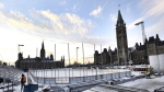 Construction continues on the skating rink on Parliament Hill in Ottawa on Monday, Nov. 20, 2017. A $5.6-million skating rink constructed on the east lawn of Parliament Hill will remain open to the public until the end of February - not just for three weeks as initially planned. THE CANADIAN PRESS/Justin Tang