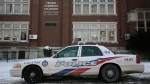 A police cruiser is parked in front of Central Commerce High School in Toronto after the school was locked down following two of its students being stabbed on Wednesday, February 4, 2009. THE CANADIAN PRESS/Darren Calabrese