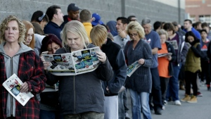 People wait in line for a Best Buy store to open for a Black Friday sale on Thanksgiving Day in Overland Park, Kan. on Thursday, Nov. 23, 2017. (AP / Charlie Riedel)